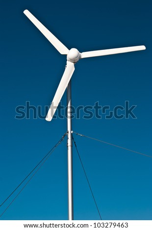 Single isolated and rotating wind turbine. Eolian power