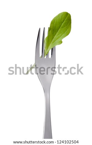 single lettuce leaf on a fork isolated against white background