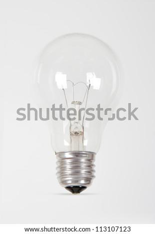 Single light bulb on white background.