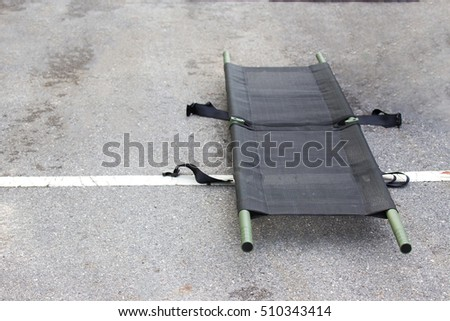single light portable stretcher for medical evacuation or medevac for law enforcement tactical team isolated on road Stockfoto ©