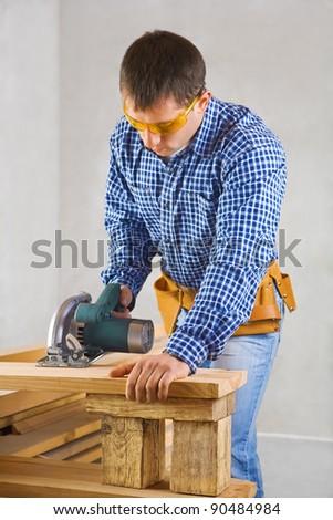 single man cuts the board