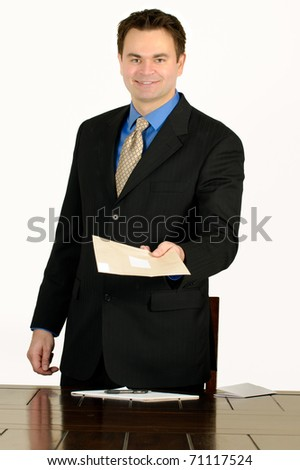 Single man in  business attire handing over an envelope with good news