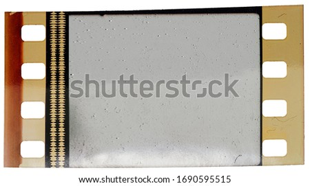 single 35mm cine film strip with empty frame isolated on white backgroud with cool texture and optical stereo sound showing the amplitude of the audio signal, analog soundfilm or phono movietone.