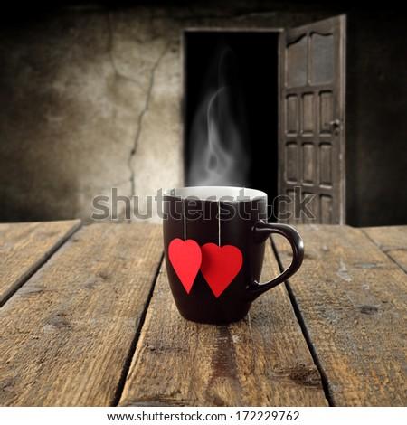 single mug and love heart on desk