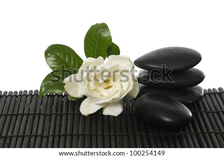 Single of gardenia flower with stone on bamboo mat