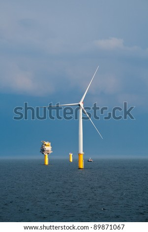 Single Offshore Wind Turbine and a Substation (Transformer) in a Windfarm under construction  off the English Coast
