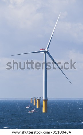 Single Offshore Wind Turbine in a Windfarm under construction  off the English Coast - stock photo