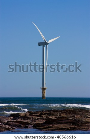Single offshore wind turbine part of a larger wind farm at cambois beach blyth, northumberland.
