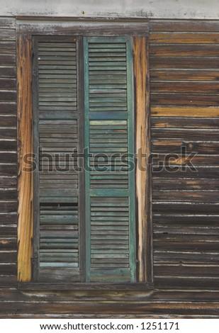 Single old wooden window blinded shut.