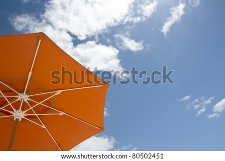Single parasol on the beach of Miami