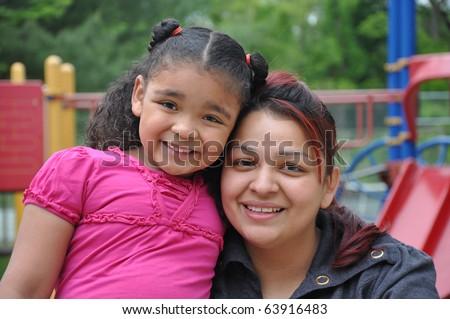 Single Parent Latin Family on Playground Closeup Tight Photograph