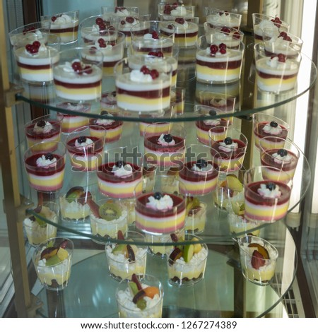 Single Portions of Mousse Packaged inside a Pastry Display Stand.