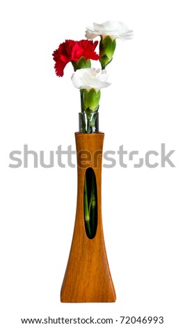 Single red and two white spray carnation blossoms in a carved teak vase with unique opening showing the stem