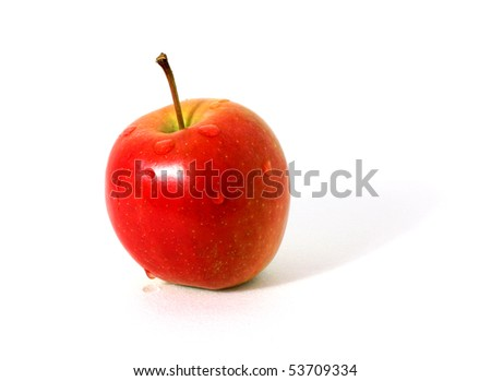 Single red apple with water drops isolated over white