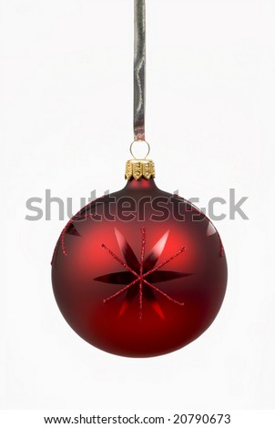 Single red Christmas ball hanging in front of white background