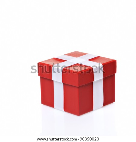 Single red gift box with ribbon on white background.