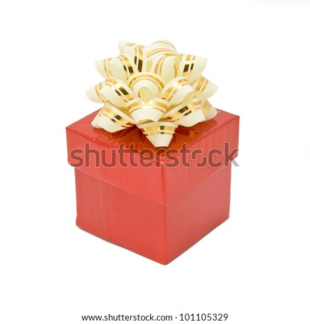 Single red gift box with silver-beige ribbon. Isolated on white background with clipping path