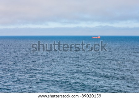 single red seiner in blue Baltic sea at sunset
