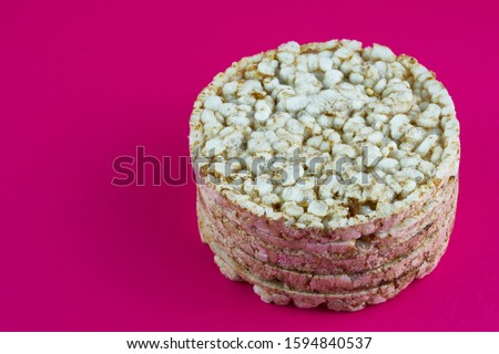 Single rice cake on the red background Foto stock ©