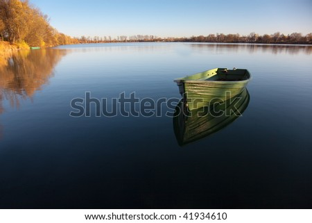 Single Rowboat on Lake with Reflection in the Water