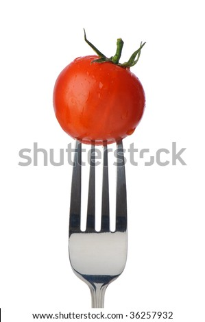 Single salad vine tomato on fork isolated on white background