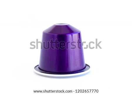 Single serve of Italian coffee espresso capsule or coffee pods on isolated white background. Can be used as an element for your design