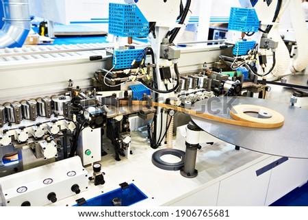 Single sided automatic edge banders on factory Zdjęcia stock ©