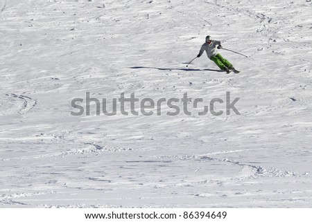 Single skier on unprepared piste - stock photo