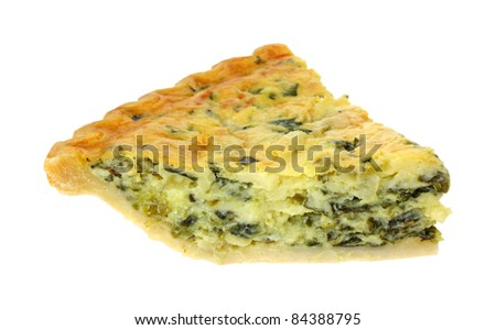 Single slice of spinach quiche on a white background.