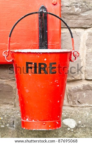 Single slightly battered fire bucket