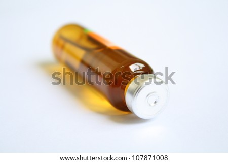 Stock Photo Single small bottle with drug isolated over white background
