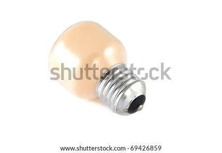 Single small light on a white background.