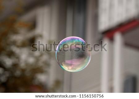 Single soap bubble against bright background #1156150756