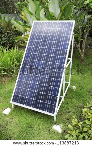 Single solar panel stand alone on the field.