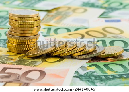 single stack coins, coins lying, symbolic photo for capital investment, risk and profit drop