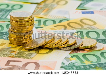 single stack coins, coins lying, symbolic photo for investment, risk and profit slump