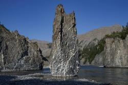 Single stone pillar in the riverbed. River Omulyovka. Magadan Region. Russia.