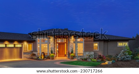 Single Story Ranch Style Luxury Home Exterior at Twilight #230717266