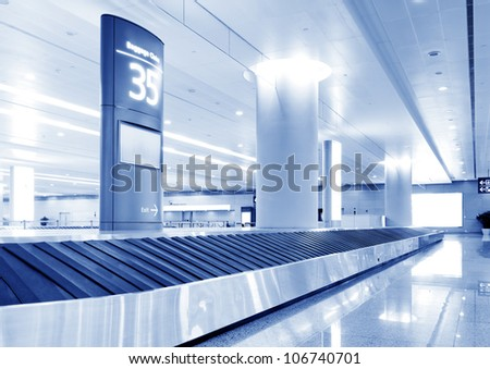 Single suitcase alone on airport carousel