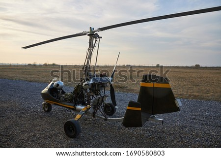 Single ultralight homemade gyroplane stands at the airdrome.