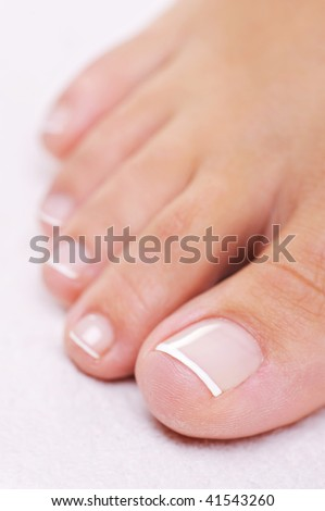 Single well-groomed female foot with a french pedicure. Close-up toy.