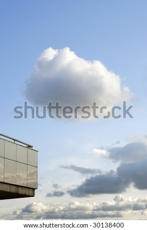 single white cloud over empty balcony of modern building
