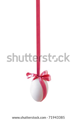 Single white easter egg with bow hanged on the pink satin ribbon isolated on white background (clipping path included)