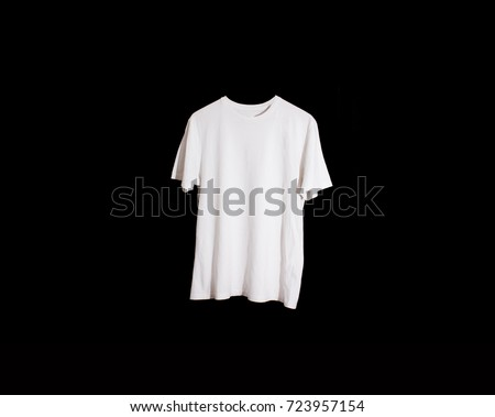 single white t-shirt on a black background, mock up, free space, logo, design, template for design print #723957154