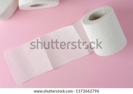 Single white toilet paper roll on pastel pink background. Space for text. Everyday use object. Hygienic object #1373662796