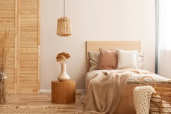 Single wooden bed with natural decoration in beige colour in kid room