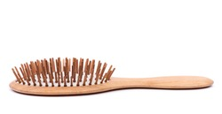 Single wooden massage brush, comb isolated on white background