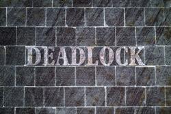 Single word Deadlock written on dark textured background