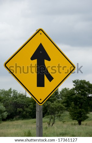 Single yellow and black merge sign