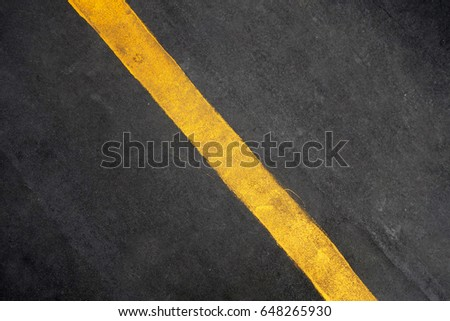 Single yellow line on road texture background #648265930